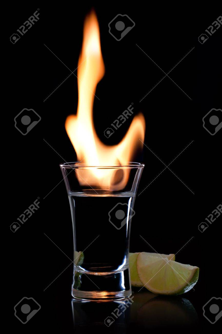 Flaming vodca, and lime over black Stock Photo - 7603738