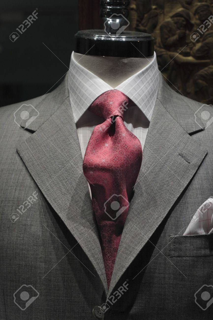 Close-up of a grey jacket with light grey checkered shirt and red patterned tie Stock Photo - 6545082