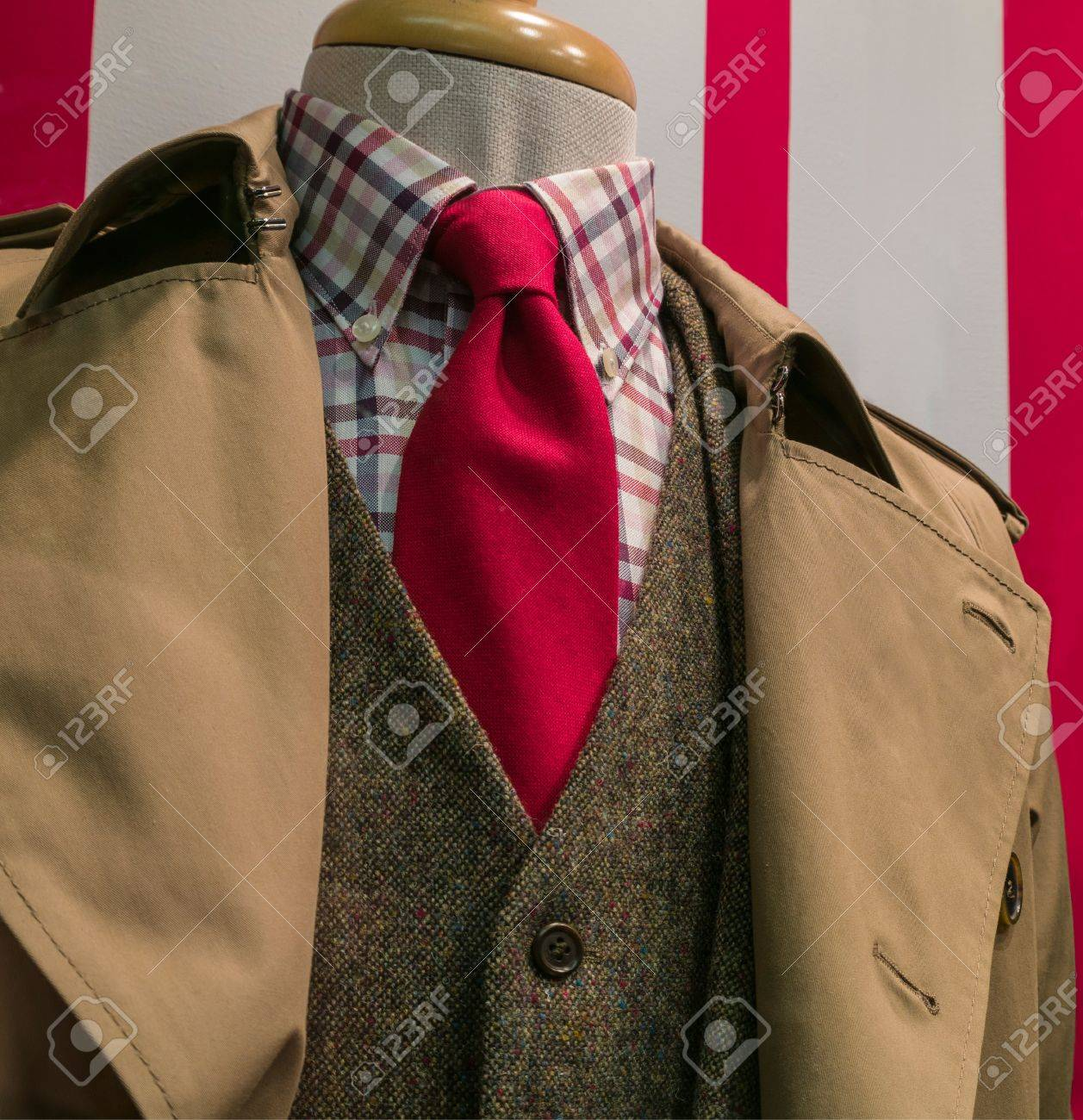 Close-ip Of A Tan Raincoat Suit, Checkered Shirt And Red Tie Stock ...