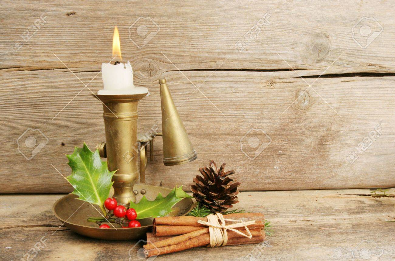 Christmas candle arrangement on a background of old rustic wood Stock Photo - 6035379