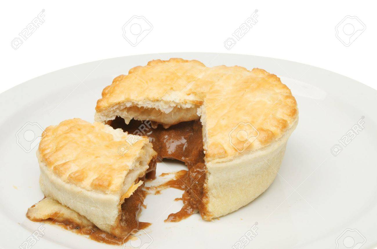 Steak and ale meat pie on a plate Stock Photo - 6481139  sc 1 st  123RF.com & Steak And Ale Meat Pie On A Plate Stock Photo Picture And Royalty ...