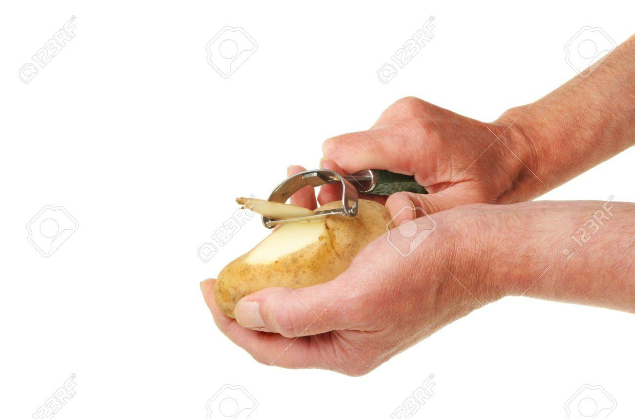Pair of male hands peeling a potato with a speed peeler against white Stock Photo - 10437792