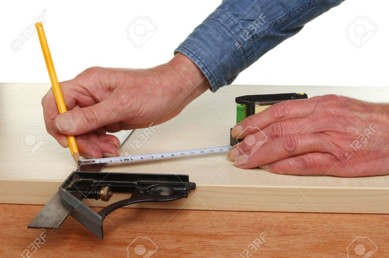 Pair of hands measuring and marking wood Stock Photo - 14771273