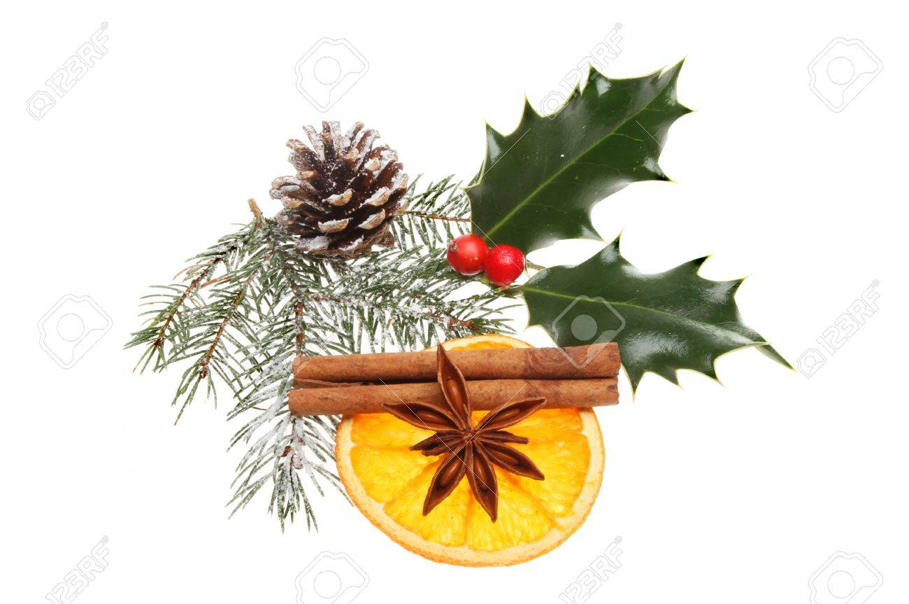 Natural Christmas decoration of snow dusted pine needlles, pine cone, holly with dried orange, cinnamon and star anise isolated against white Stock Photo - 16642167