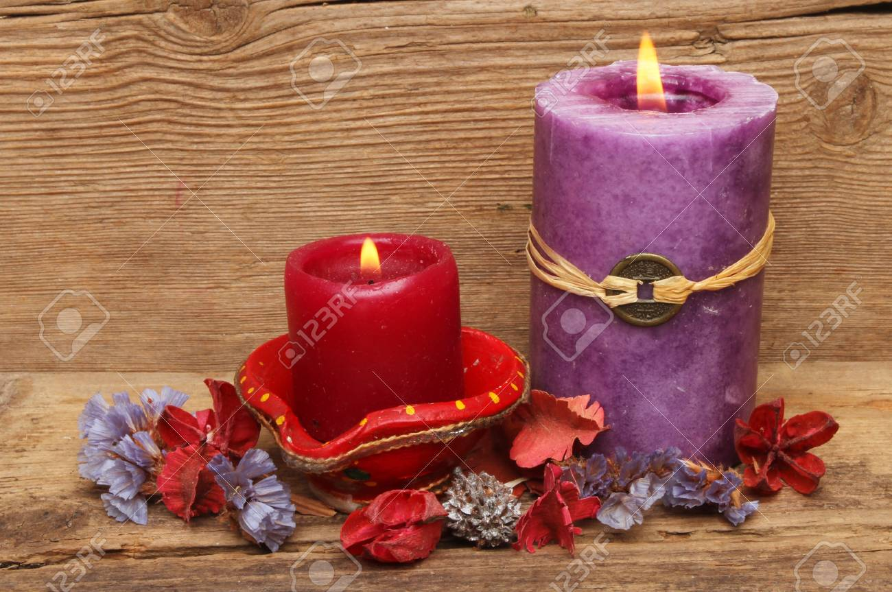 Red and purple candles with potpourri on a background of old weathered wood Stock Photo - 18179029