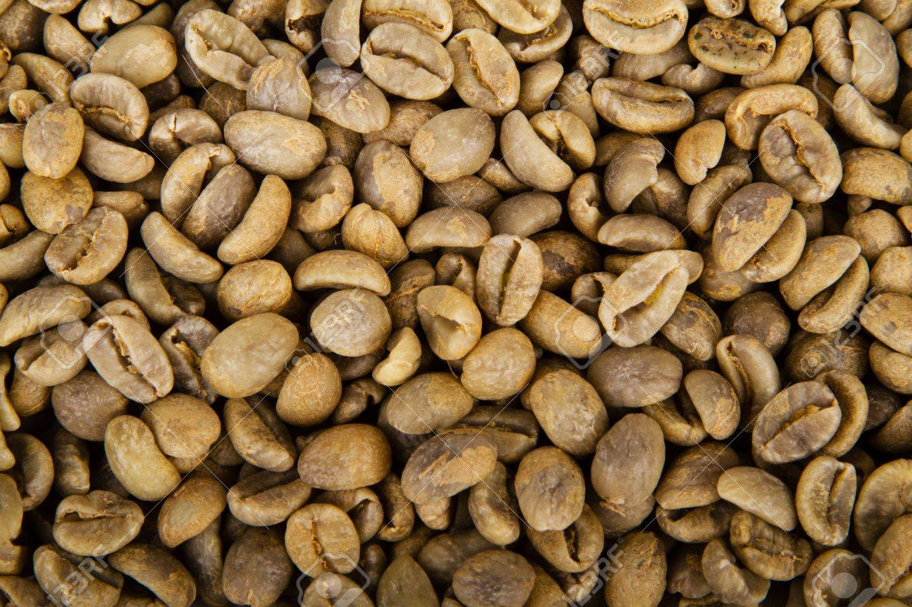 Heap of green coffee beans isolated on white background Stock Photo - 18289492