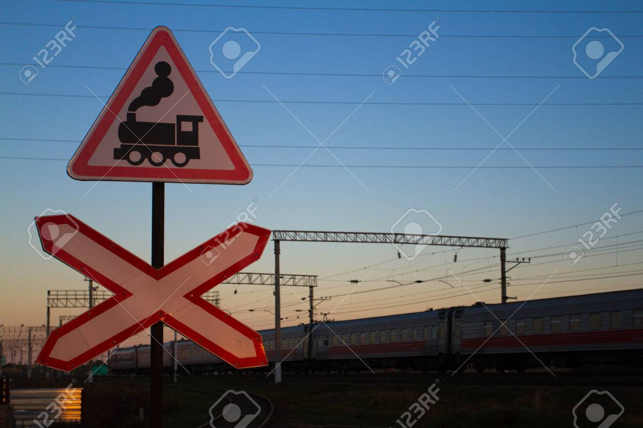 a stop sign in front of a moving train stock photo, picture and