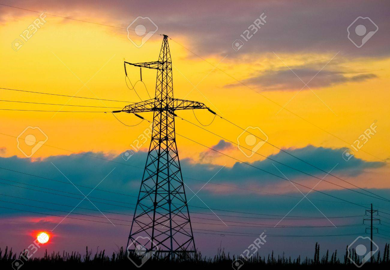 High voltage tower  on a background of the sunset Stock Photo - 10998579
