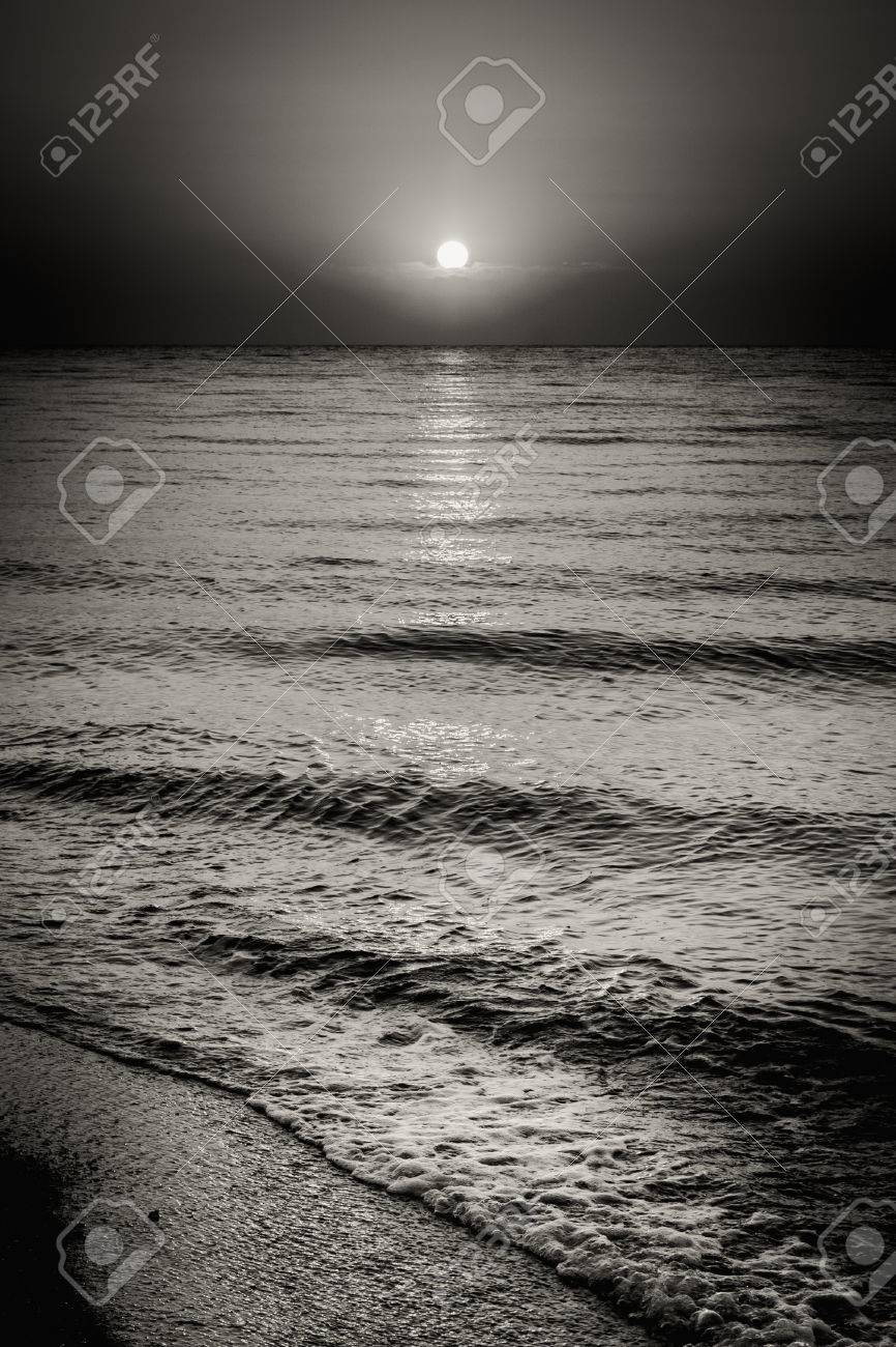 Black and white dramatic landscape with sea ocean water waves