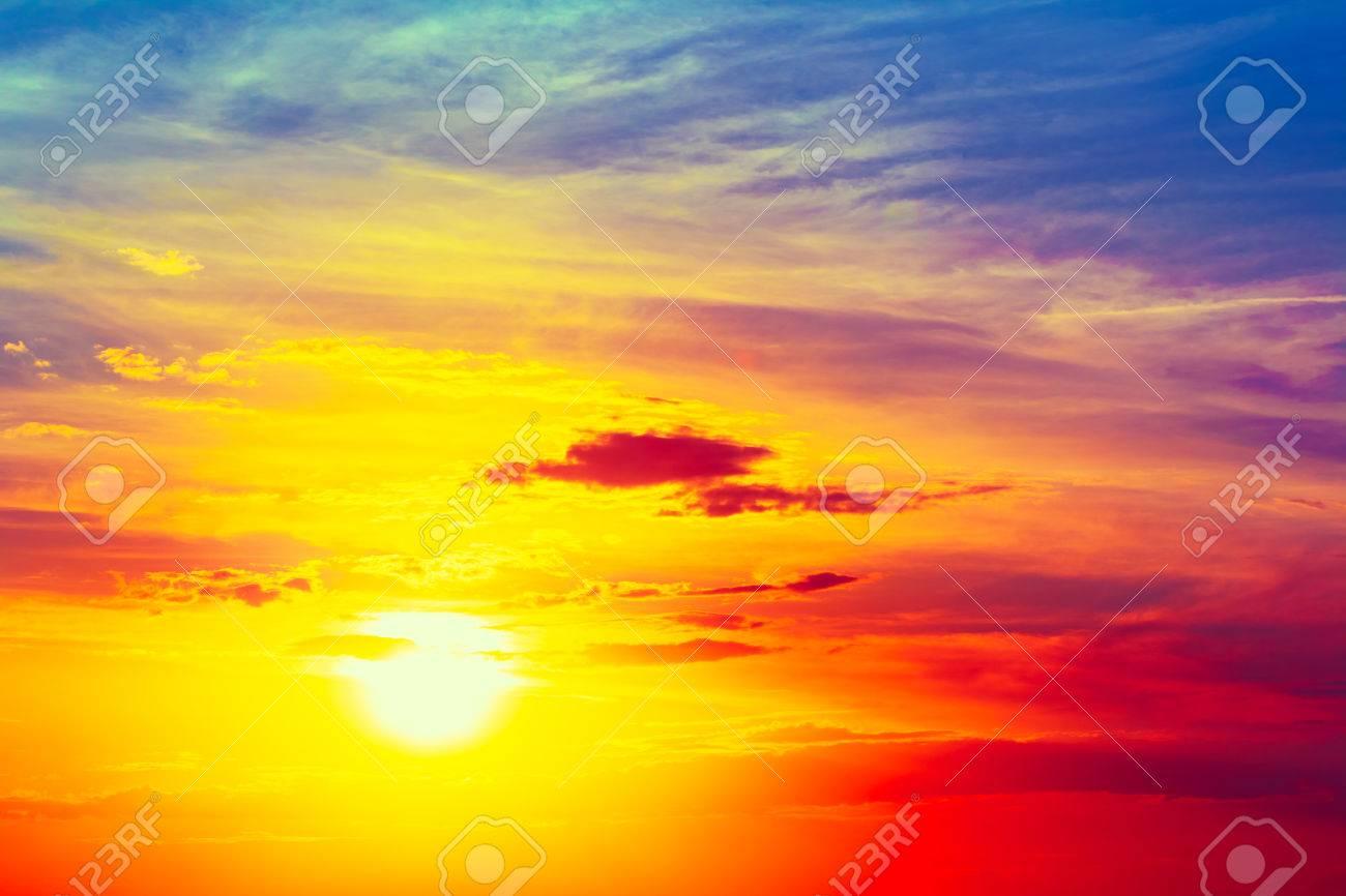 sun shining in bright blue orange and yellow colors sunset sunrise