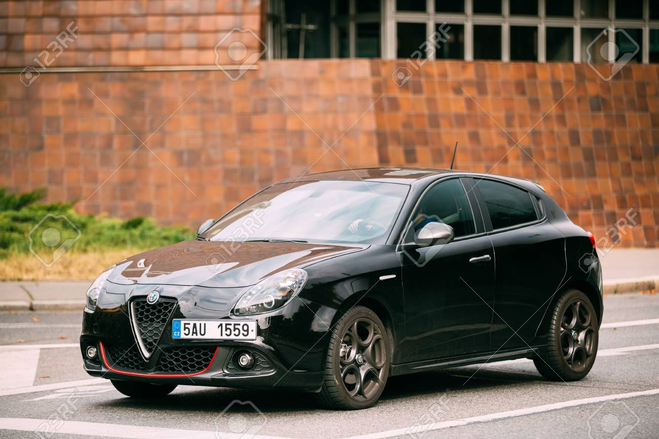 side view of alfa romeo giulietta veloce 940 car of black metallic