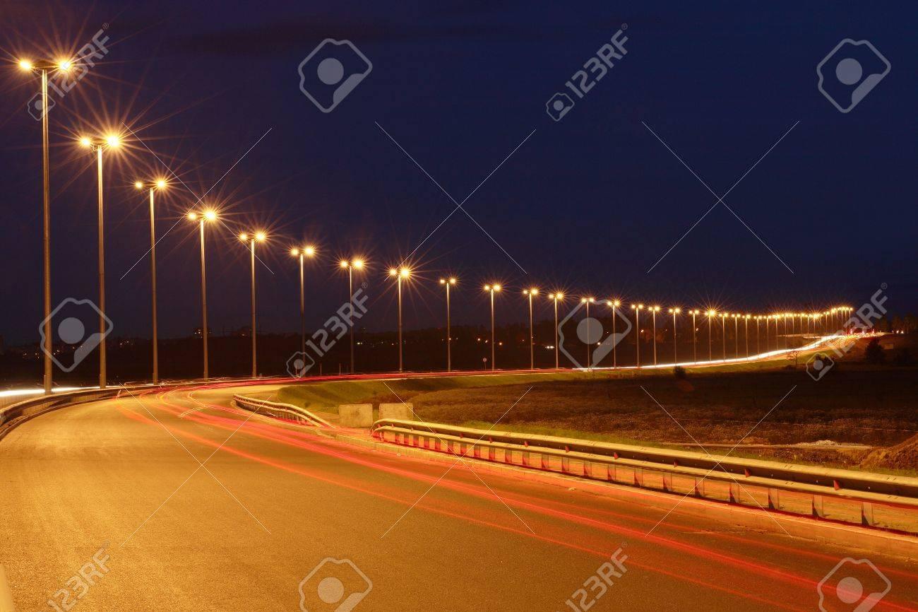 Lighting The Night Highway Road Lighting Masts Night View Horizontal Photo Banco De Imagens Royalty Free Ilustracoes Imagens E Banco De Imagens Image 17992410