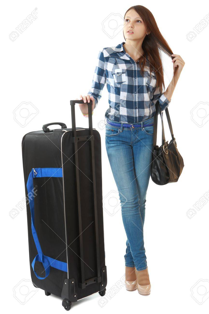 Teen Girl With A Big Black Travel Bag On Wheels Stock Photo ...