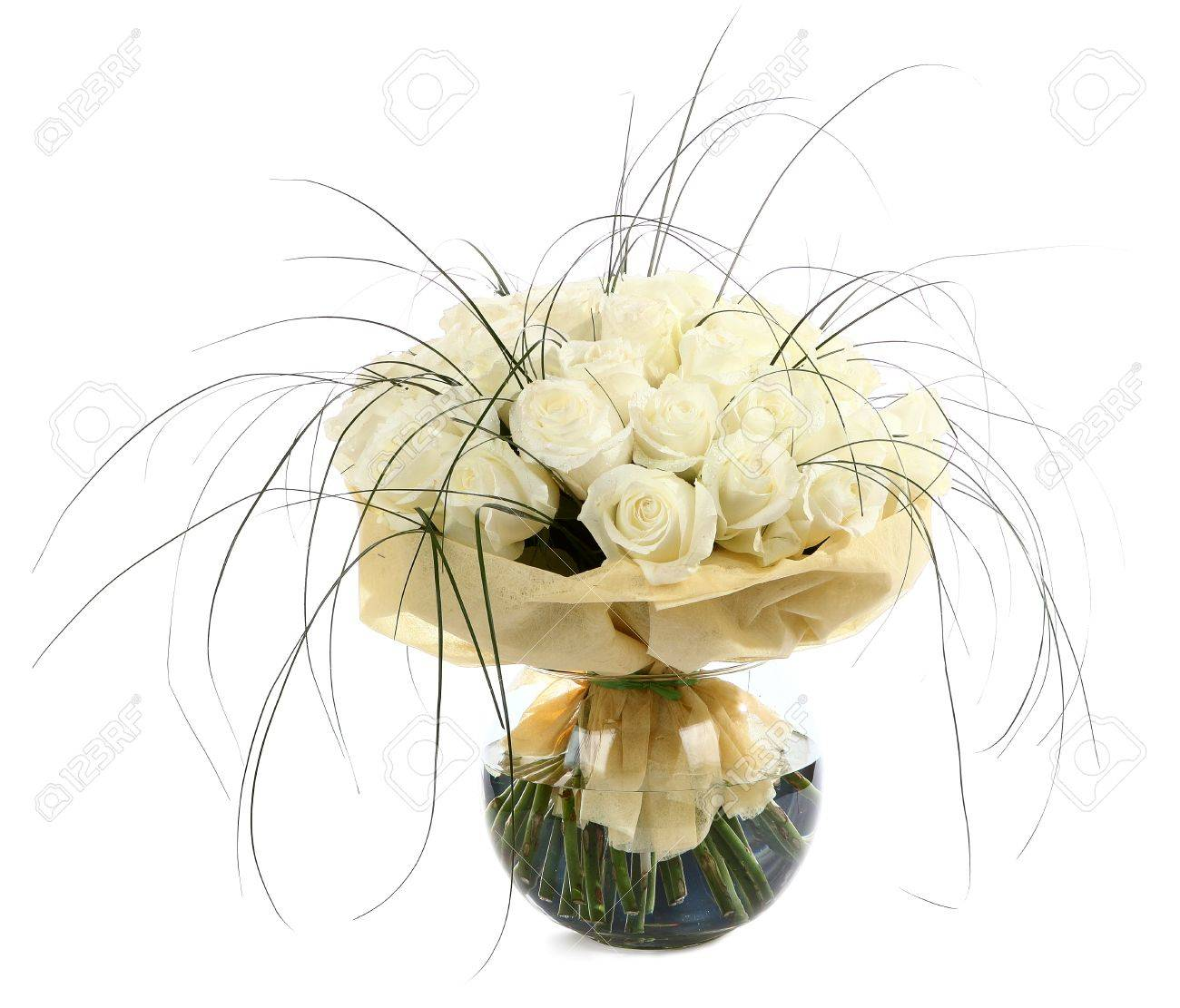 A Large Bouquet Of White Roses In A Transparent Glass Vase The