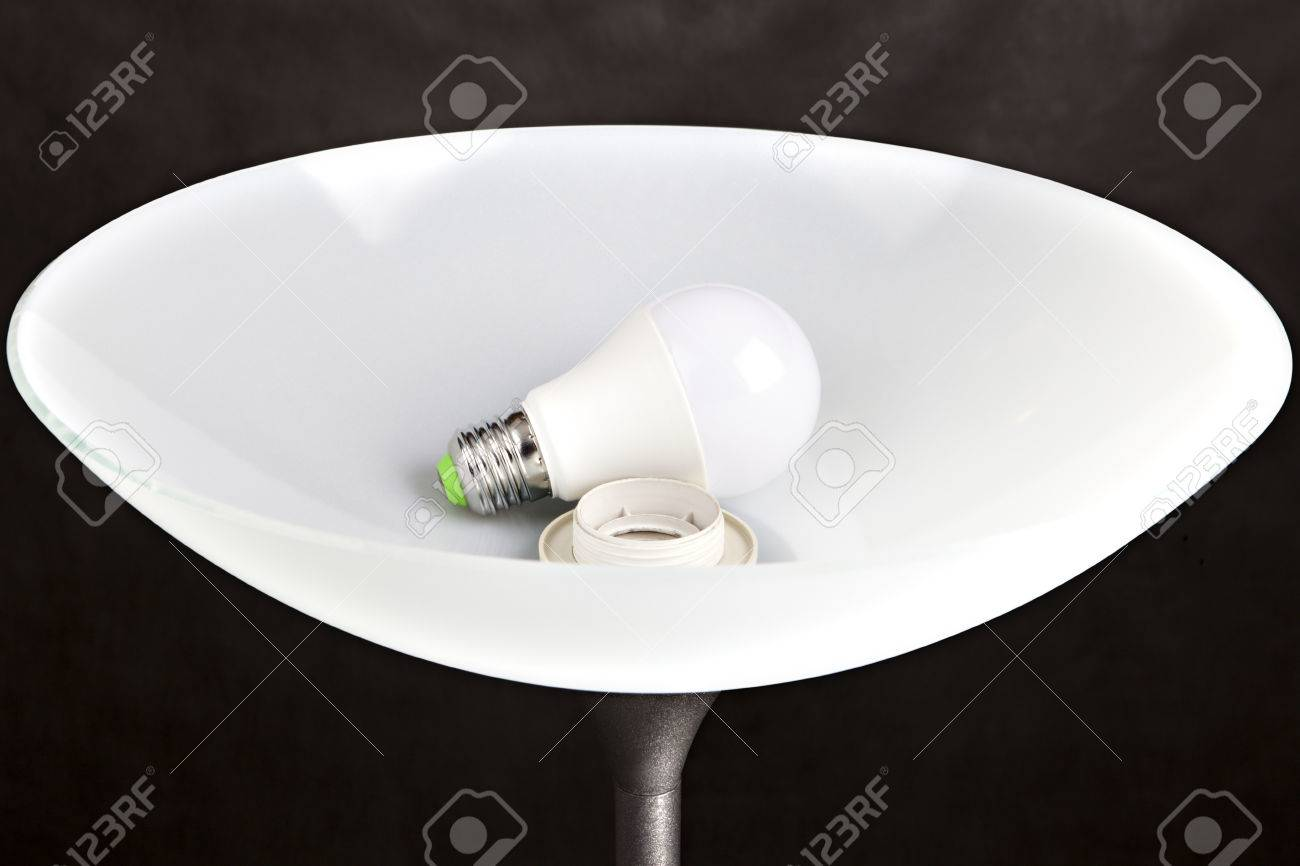Energy efficient led low energy light bulb is in the a plafond energy efficient led low energy light bulb is in the a plafond white frosted aloadofball Gallery