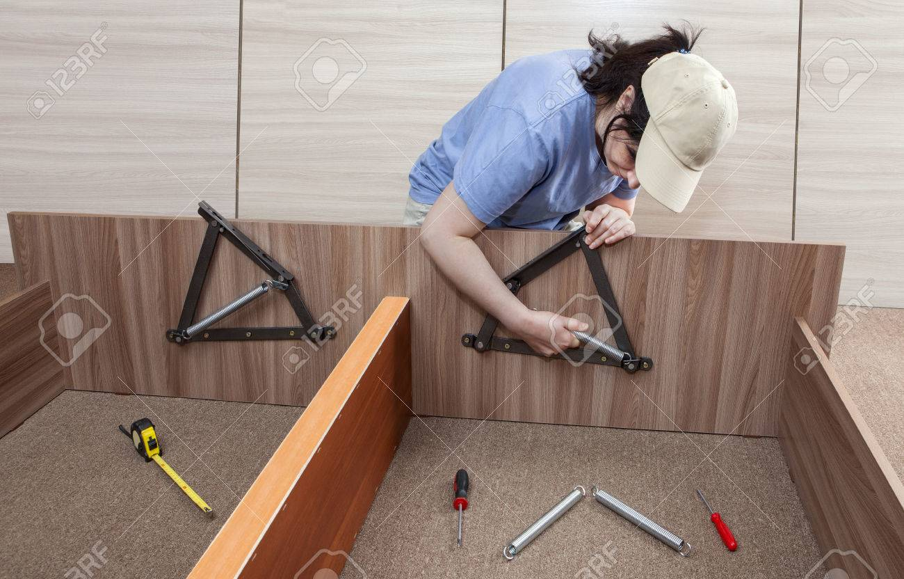 Self Assembling Furniture At Home, Women Putting Together Self ...