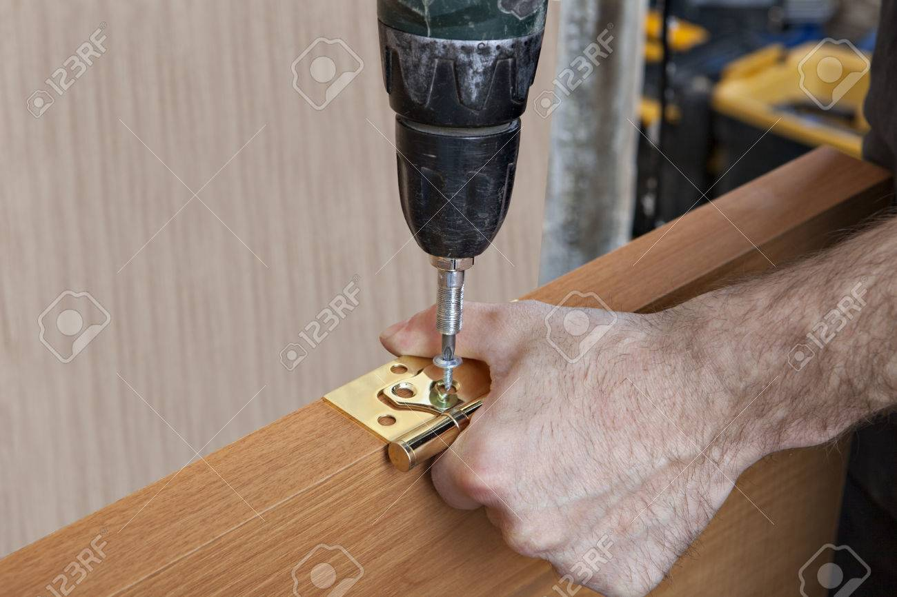 Door installation install hinges for wooden interior door door installation install hinges for wooden interior door carpenter screwing screws close planetlyrics Image collections