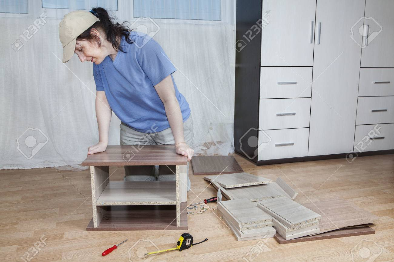 Flat Pack Furniture, Woman Assembling Wooden Bedside Tables,.. Stock ...