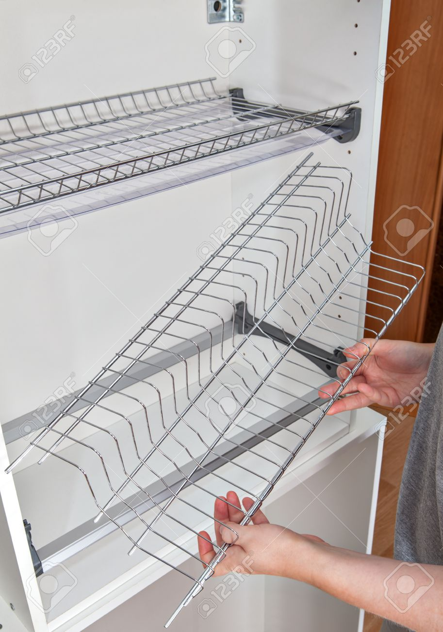 Install Wall Mounted Shelf Under Kitchen Cabinet With Inside.. Stock ...