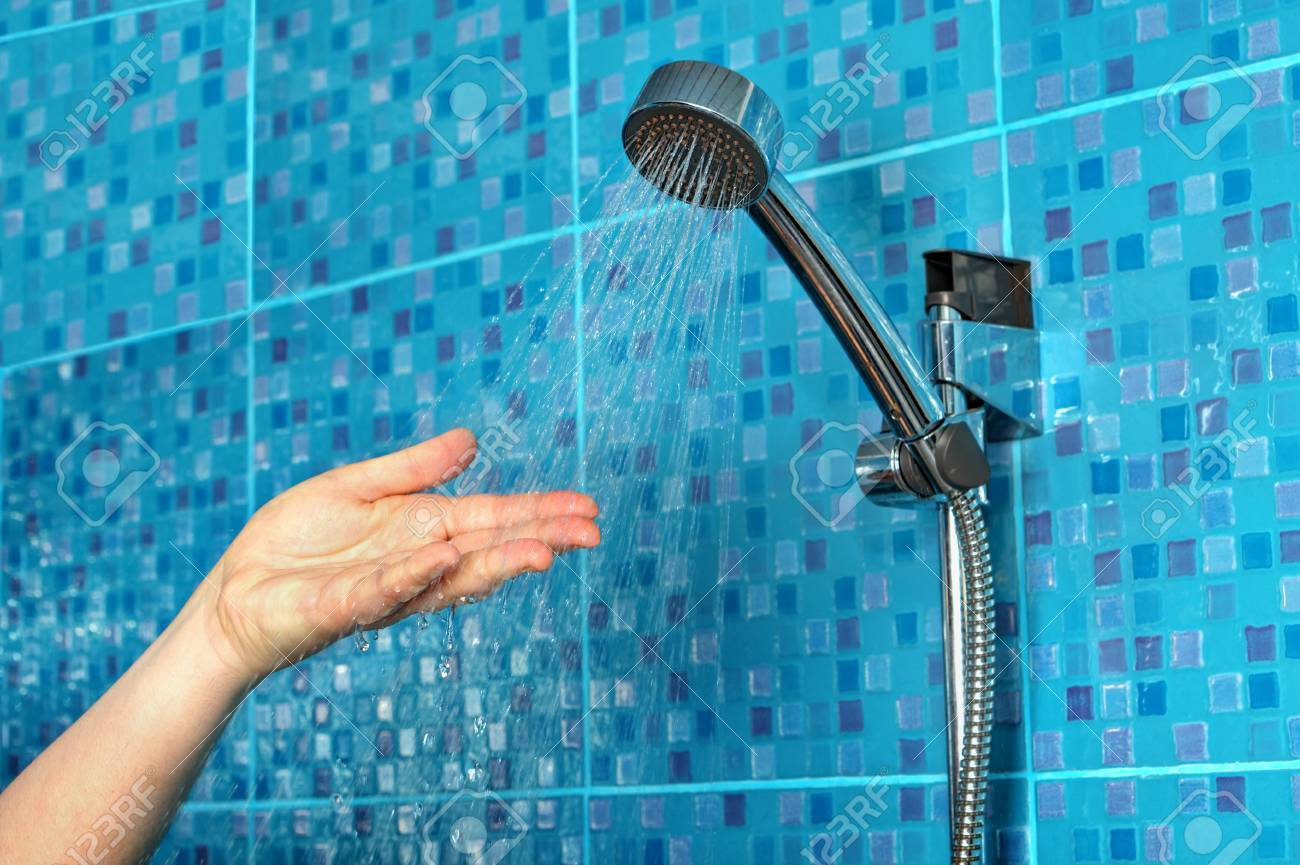 Close-up Of A Woman\'s Hand Check Water Temperature In The Shower ...