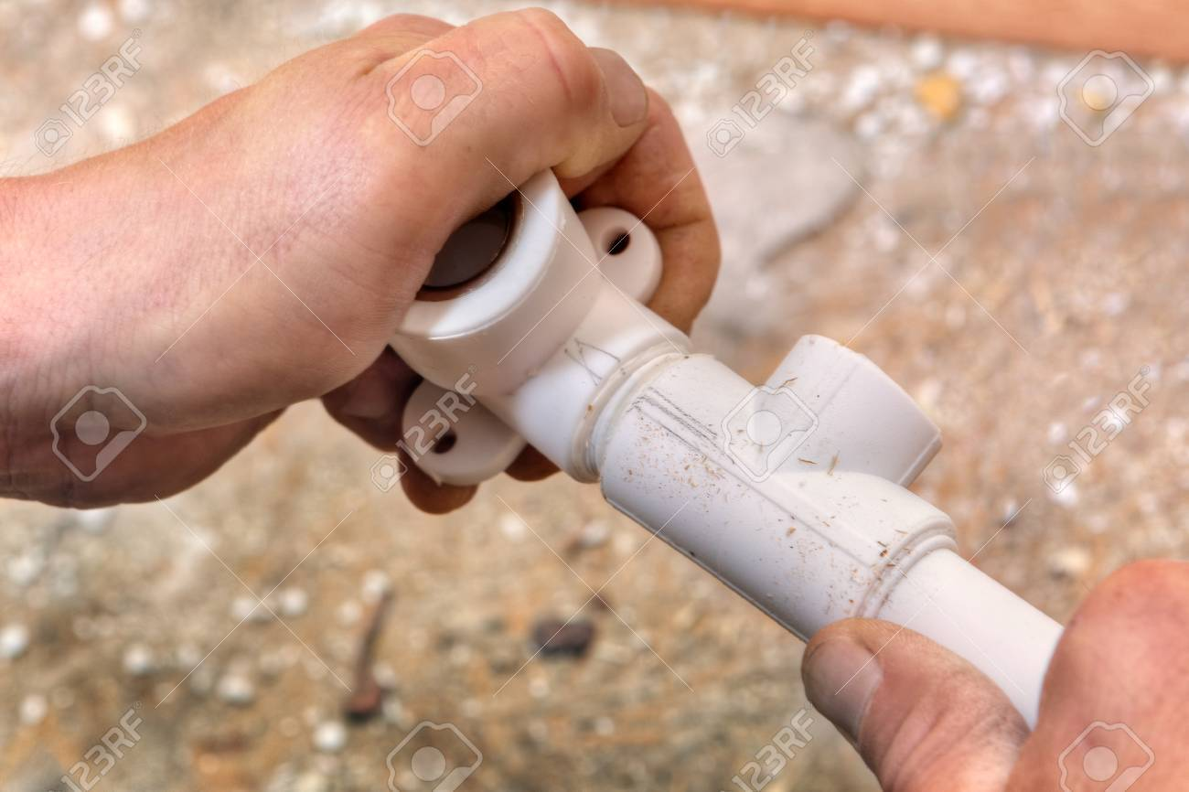 The Plumber Connects Parts Of The Plastic Water Pipe Using Fittings ...