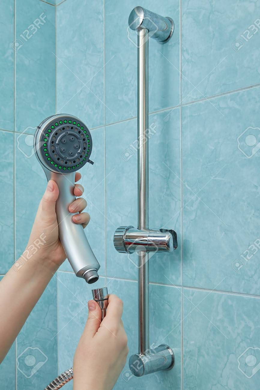 Female Hands Change The Shower Head To A New One In The Bathroom ...