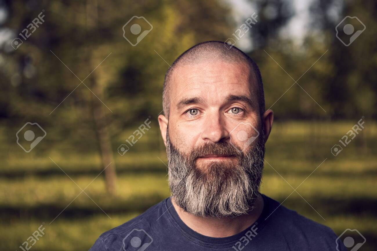 A White Man About 43 Years Old With Short Hair And Beard Has