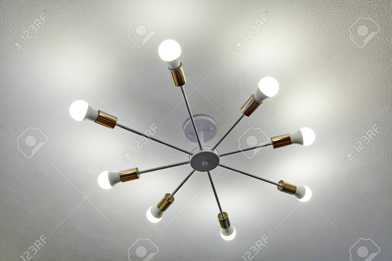 Aluminum ceiling chandelier with eight beams, at the end of which are of LED light bulbs. Economical home lighting. - 148831380