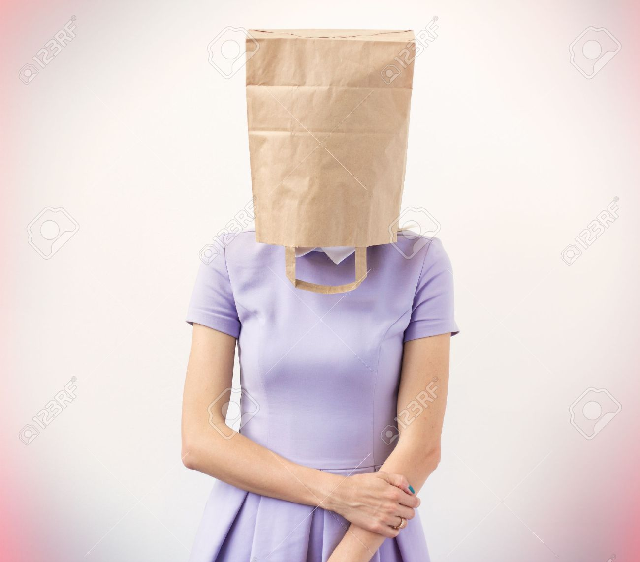 29799356-young-woman-with-paper-bag-over