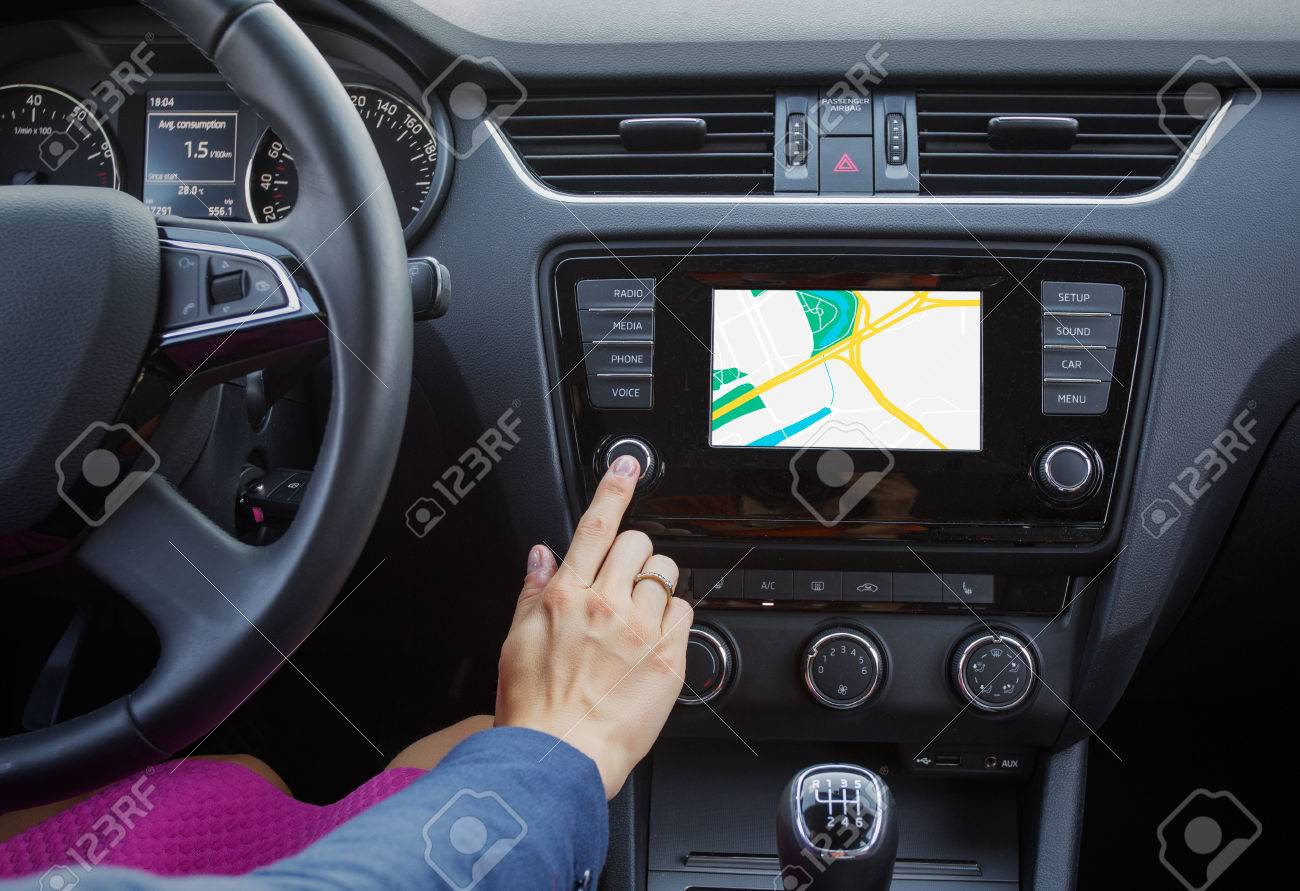 Woman using navigation system while driving a car - 31575244