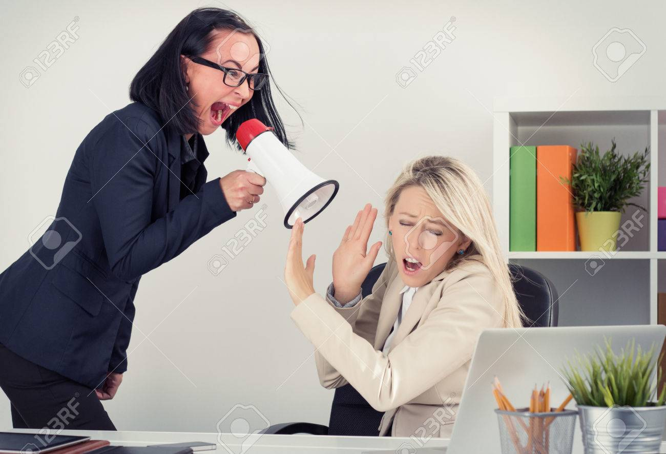 bad boss stock photos images royalty bad boss images and bad boss mad boss shouting at employee on megaphone