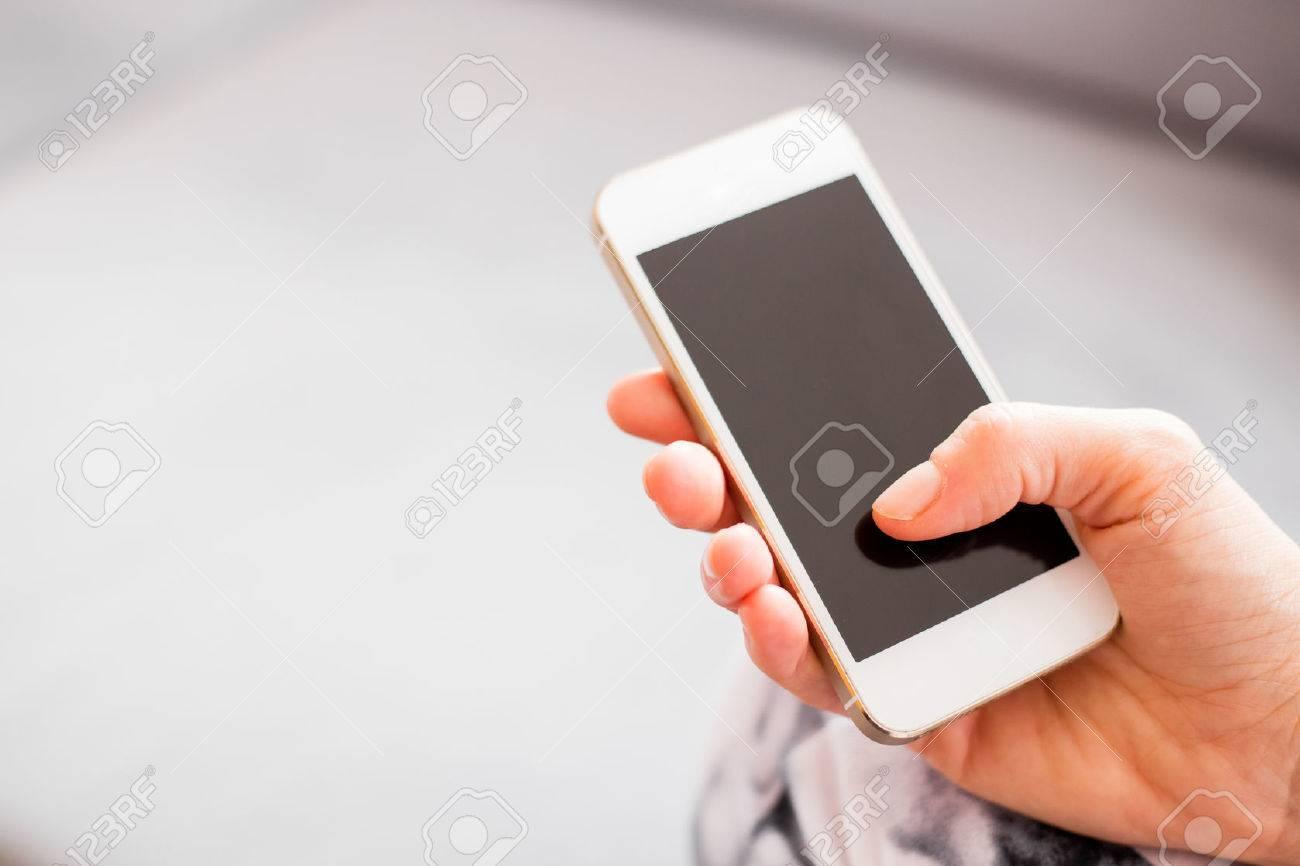 Woman holding smartphone - 36105829