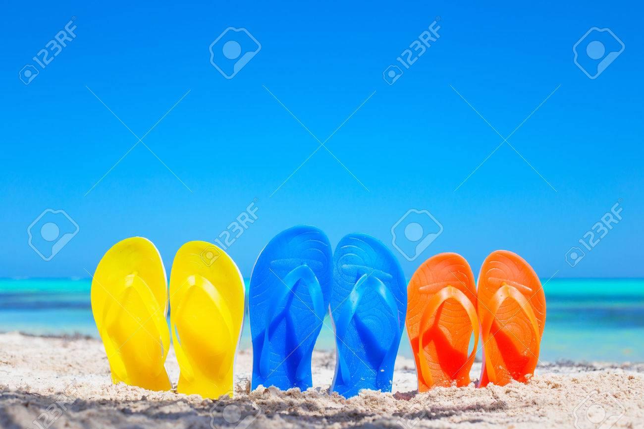 cd813a09c609d JoJo  Colorful beach flip flops sandals on the beach Stock Photo - 38874972  sneakers 1391e 4012b ...