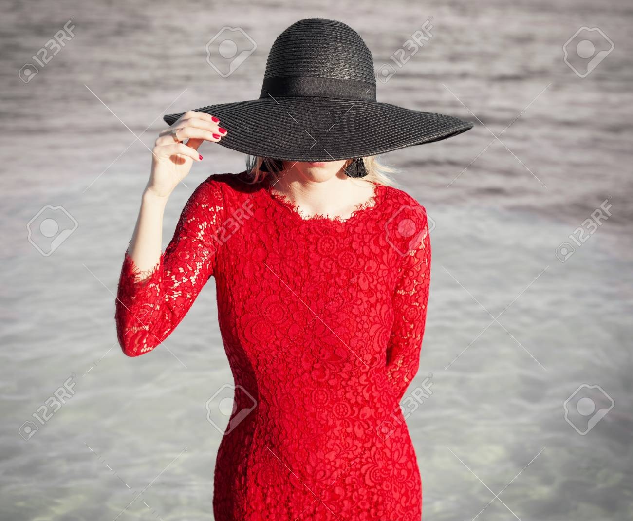 Stock Photo - Woman in red dress and black hat 894f68acd6d