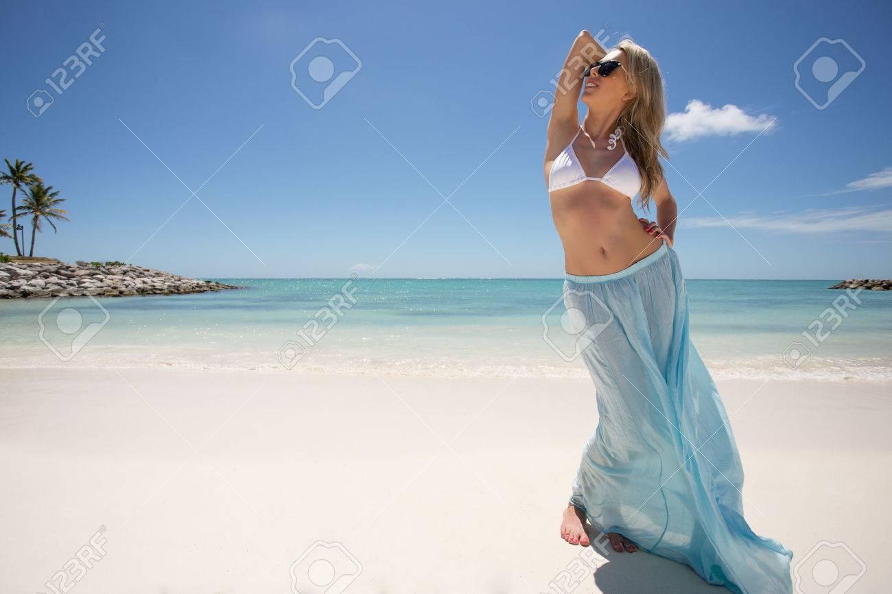 Woman enjoying tropical weather on the beach - 45461541
