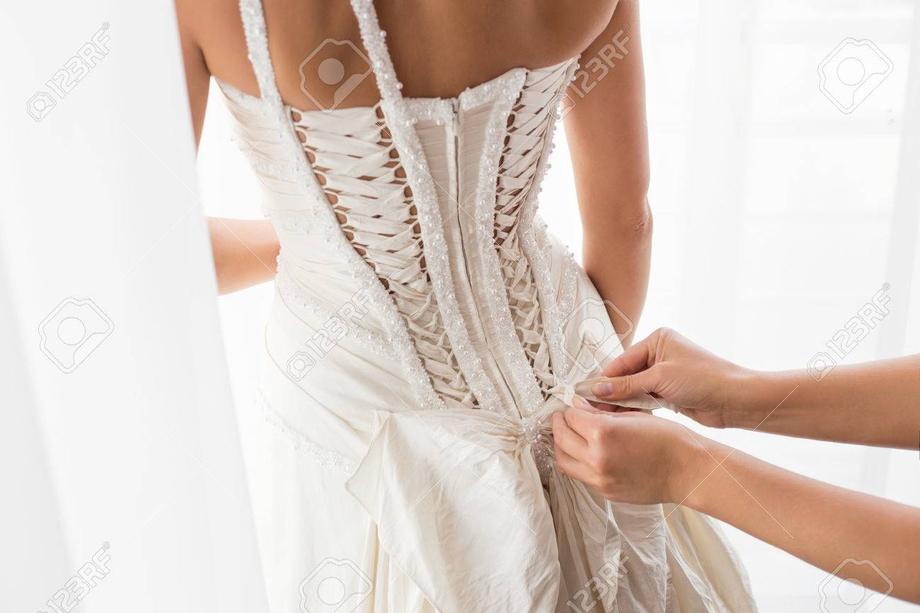 Helping bride with a dress Stock Photo - 46101838
