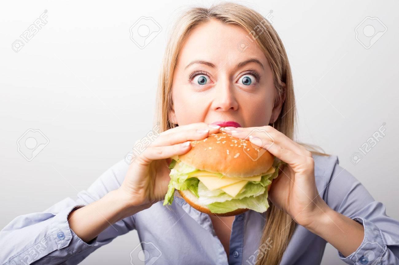 Woman eating burger - 54246631