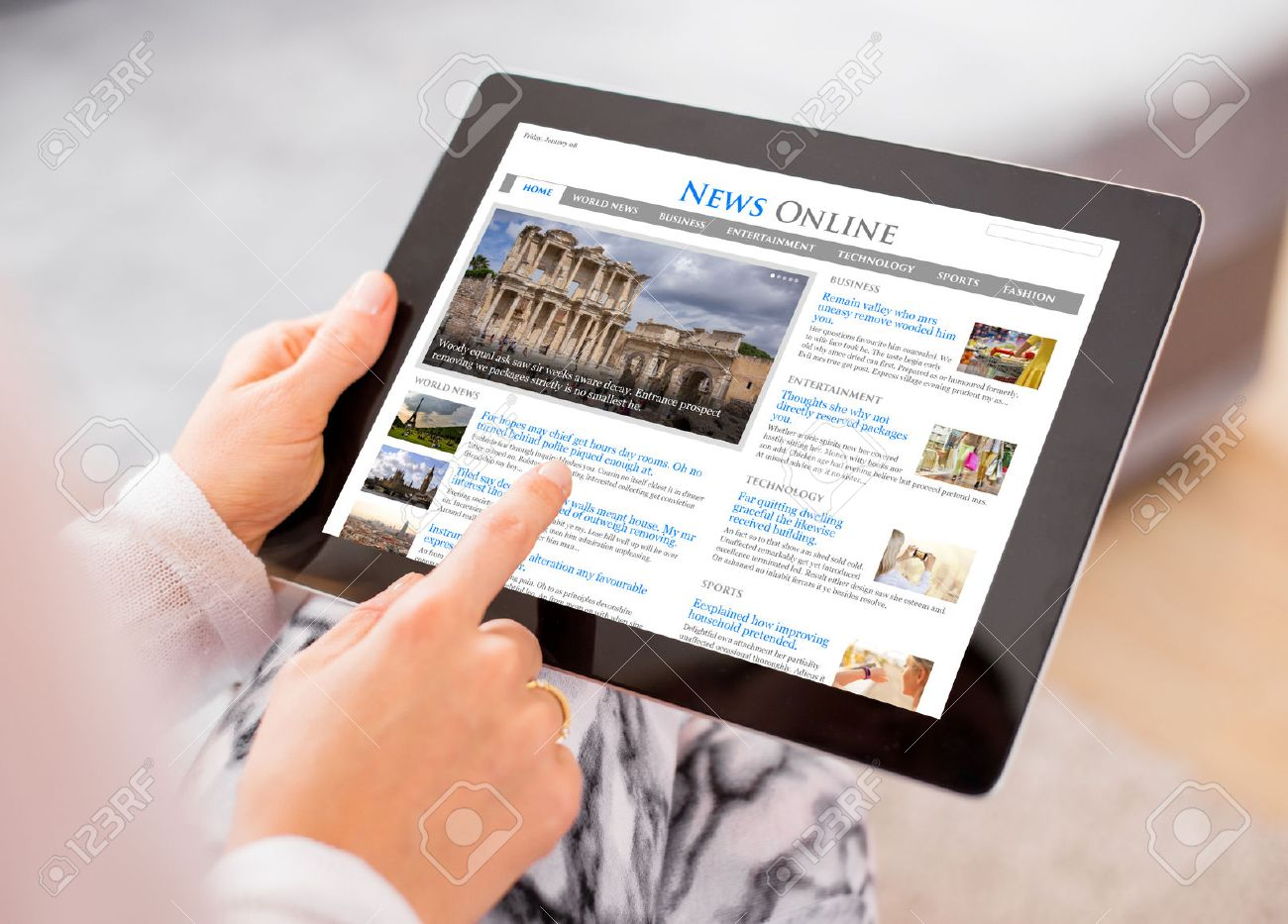 Sample news website on digital tablet. Contents are all made up - 54247374