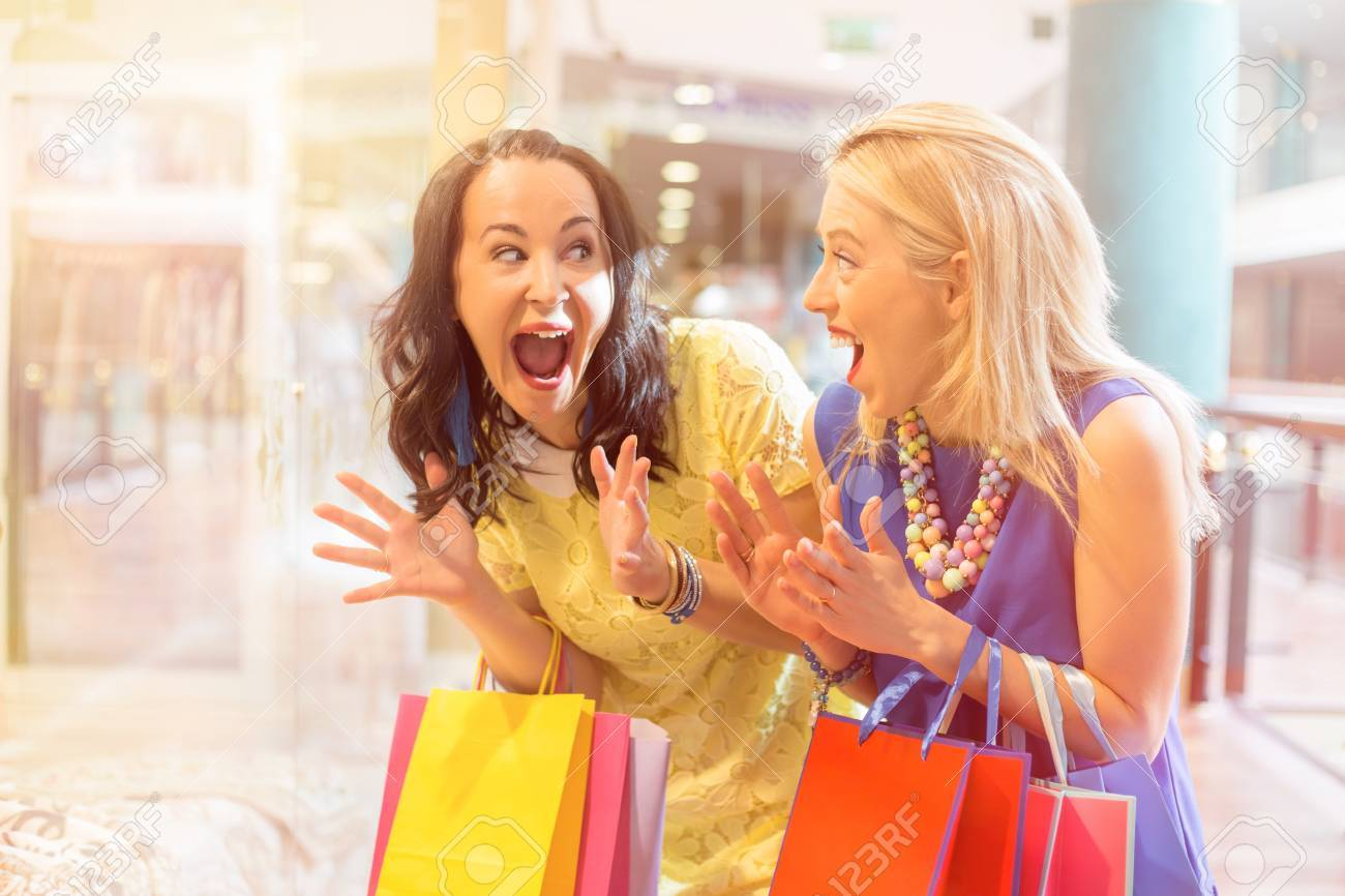 Excited friends at the shopping mall - 59197836