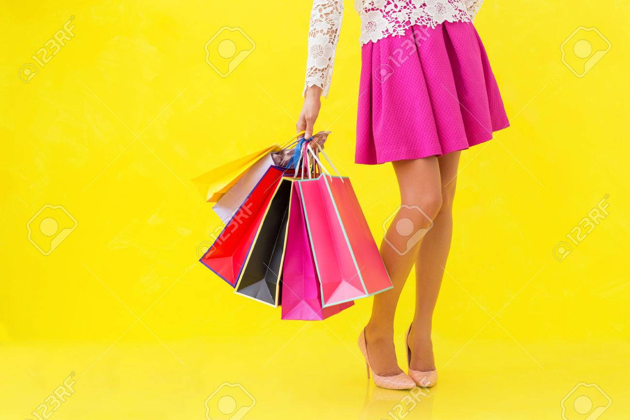 Woman holding many shopping bags - 60165952