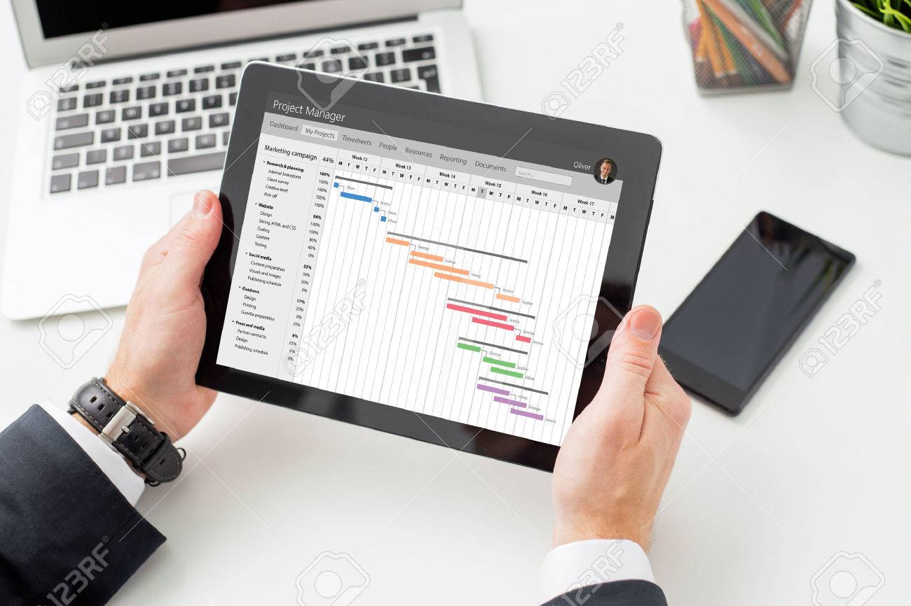 Businessman looking at gantt chart on tablet computer stock photo businessman looking at gantt chart on tablet computer stock photo 71930363 nvjuhfo Choice Image