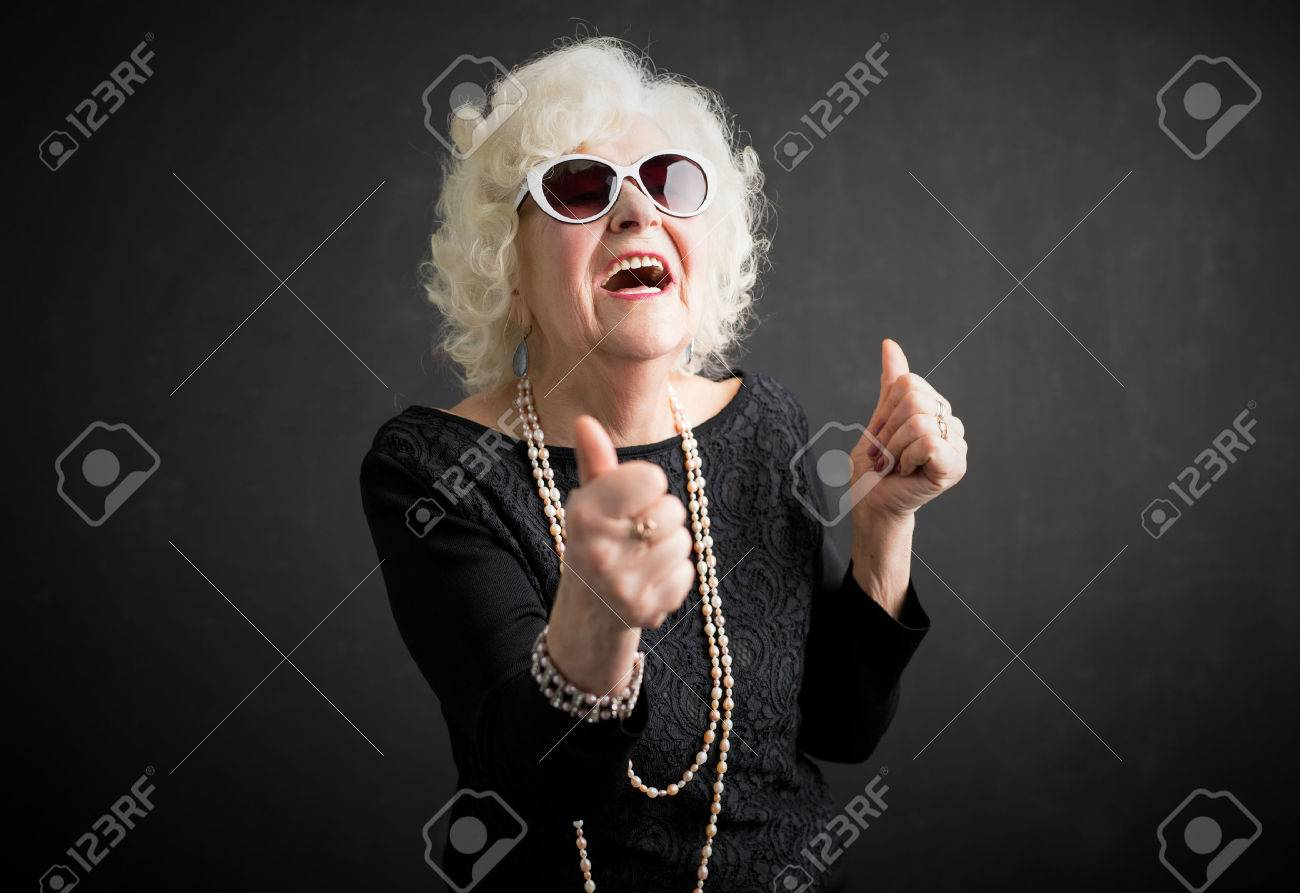 Cool grandma with her thumbs up - 72658890