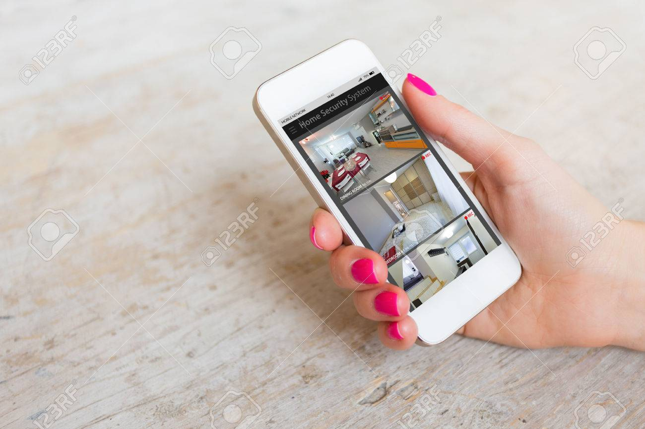 Home security cameras viewed on mobile phone - 72780014