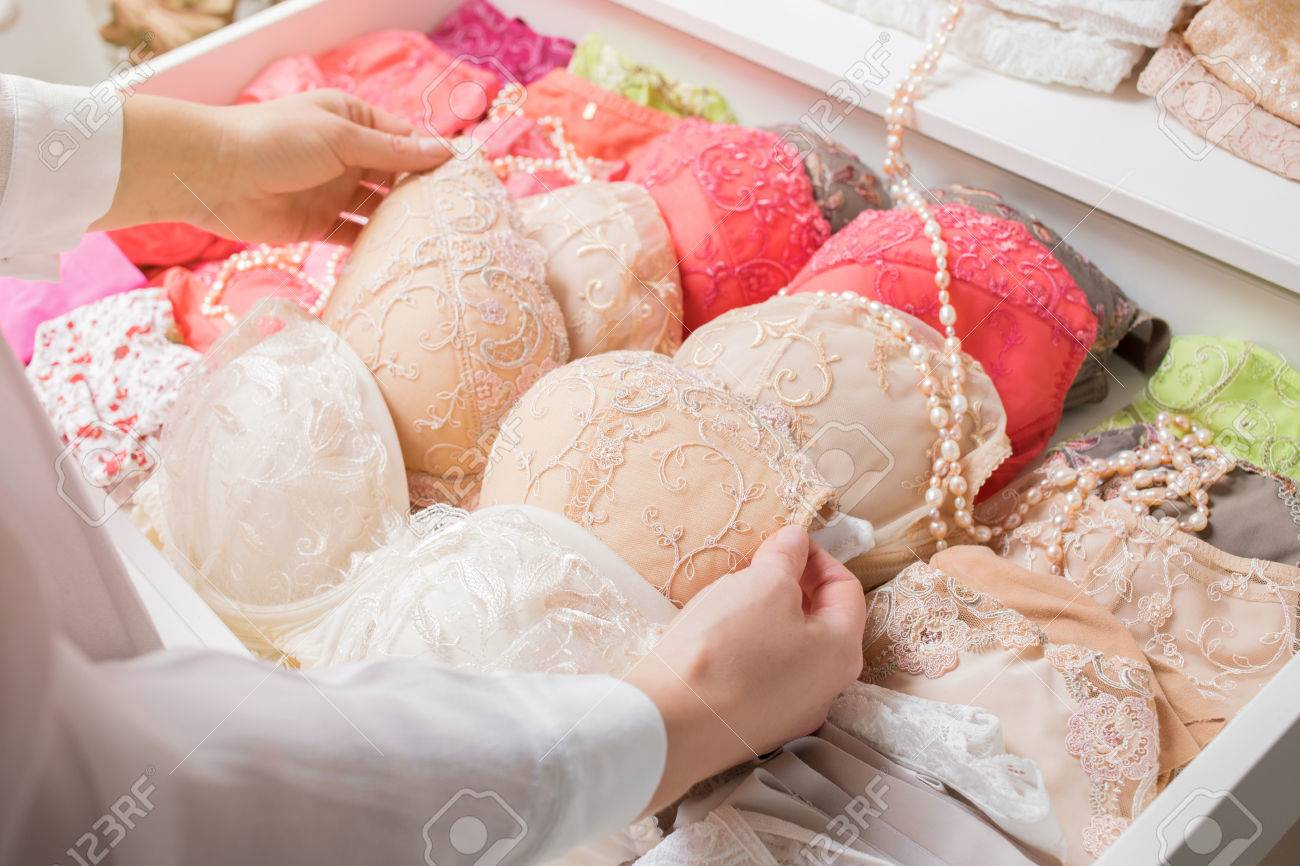 c9ce6fb7d2 Woman organizing underwear Stock Photo - 73362850