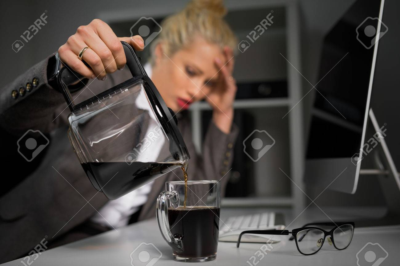 Woman pouring coffee in cup - 74114587