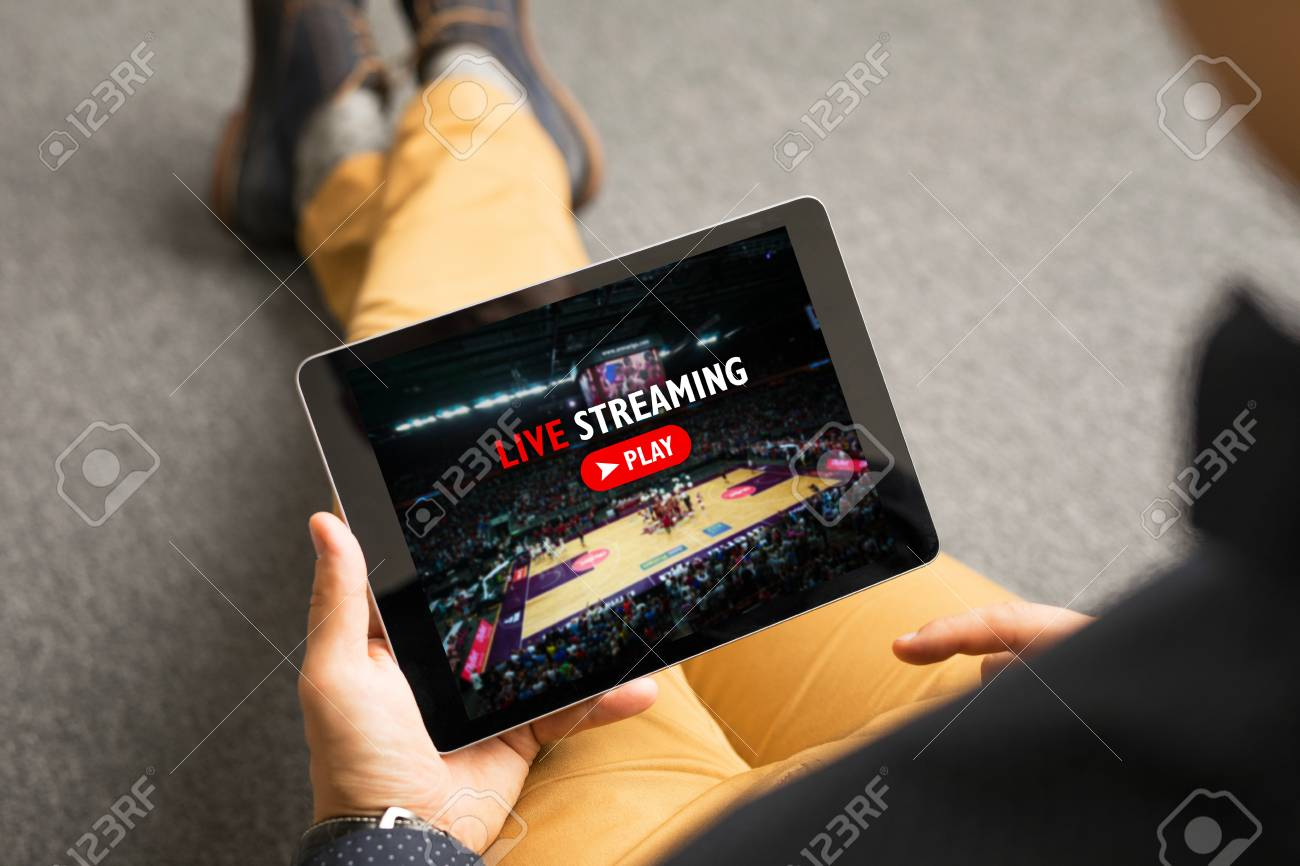 Man watching sports on live streaming online service - 97324102