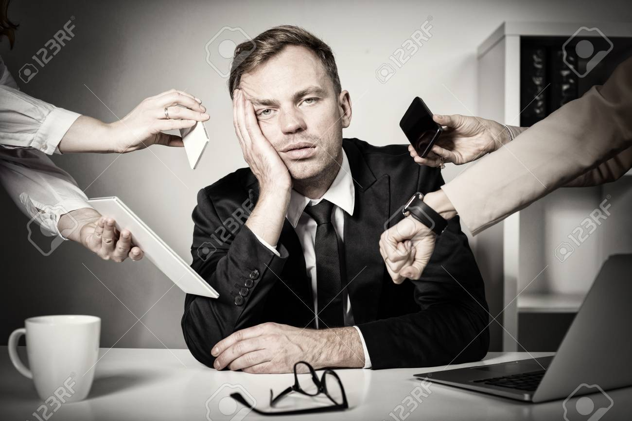 Man overwhelmed with tasks and responsibilities at work - 108462596