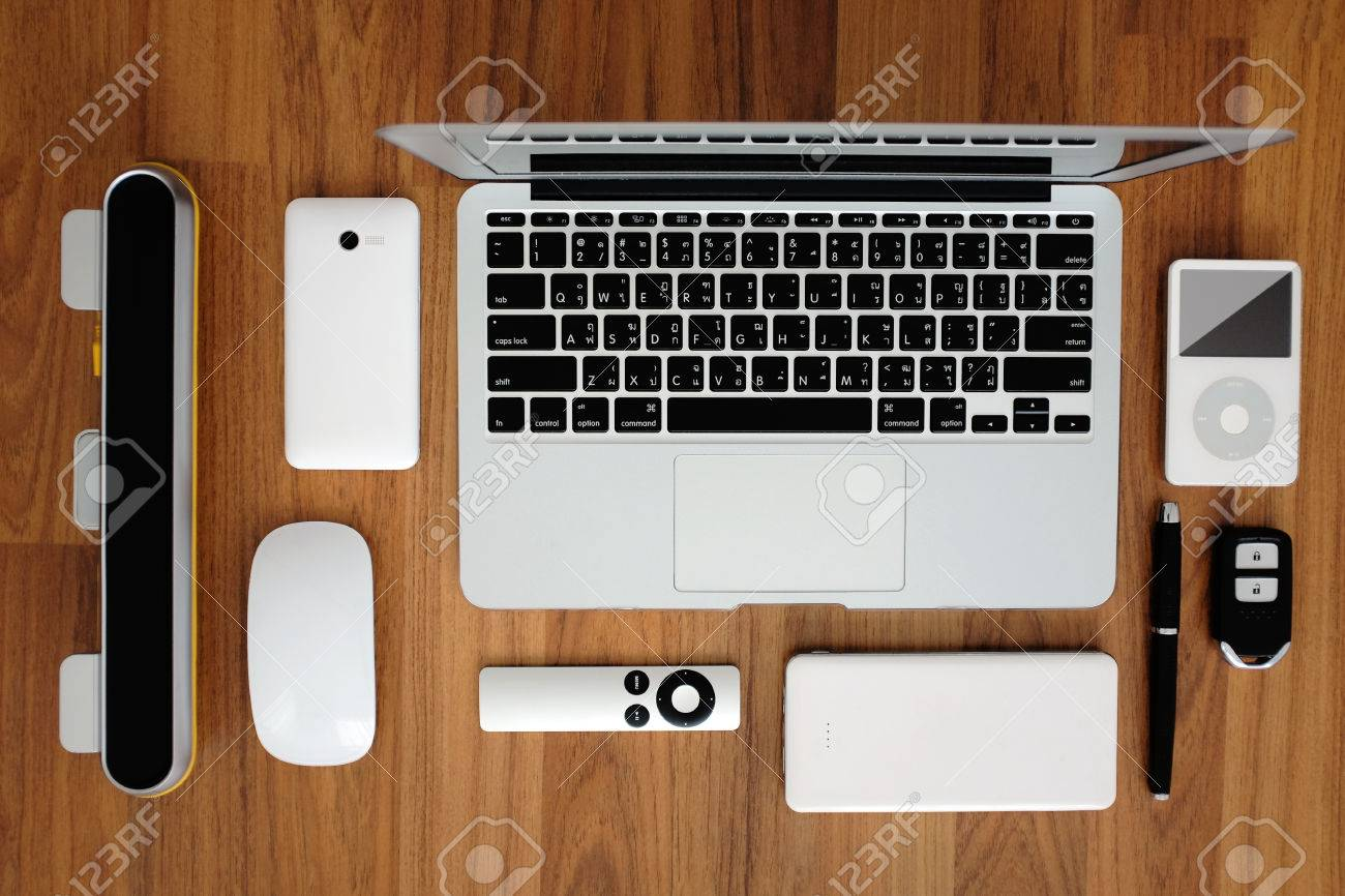 Top view flat layout of laptop computer with smartphone, remote,