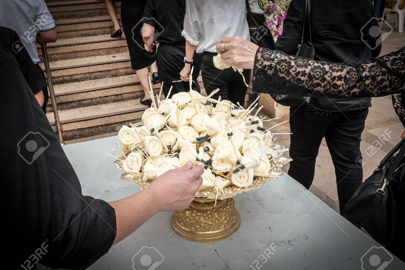 People picking paper flower at a buddhist funeral thailand stock people picking paper flower at a buddhist funeral thailand stock photo 69453680 mightylinksfo Gallery