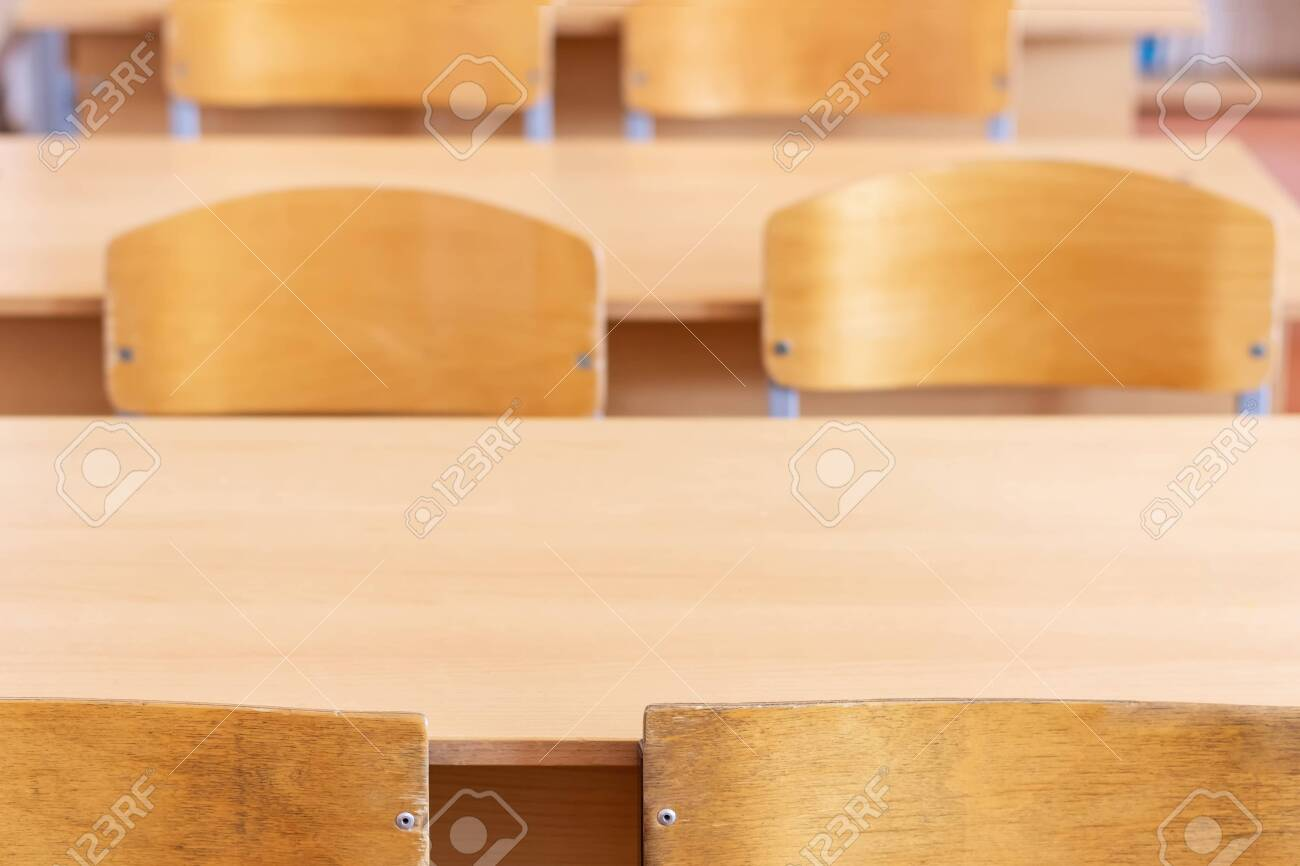 School desks and chairs in a school class, close-up. Beginning..